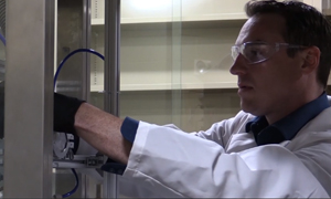 Scientist working in a lab as a link to a video about nanodiamonds